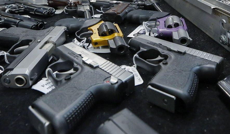 In this Jan. 26, 2013, photo, handguns are displayed on a vendor's table at an annual gun show in Albany, N.Y. In a study looking at data from 2006-14, serious gun injuries including many from assaults sent 75,000 U.S. children and teens to emergency rooms over the nine years. Results were released on Monday, Oct. 29, 2018. (AP Photo/Philip Kamrass) **FILE**