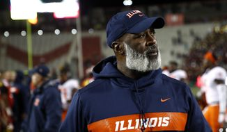 Illinois head coach Lovie Smith walks off the field after an NCAA college football game against Maryland, Saturday, Oct. 27, 2018, in College Park, Md. (AP Photo/Patrick Semansky)