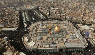 This Sunday, Oct. 28, 2018, aerial photo shows Shiite pilgrims gathering between the holy shrine of Imam Hussein, top, and the holy shrine of Imam Abbas, bottom, in Karbala, Iraq. Millions of Shia Muslims from around the world are making the journey to the holy shrines of their saints Hussein and Abbas in Karbala, Iraq, in a pilgrimage that is as much about camaraderie as religion. The annual commemoration, called Arbeen, brings more pilgrims each year than the Hajj, in Saudi Arabia, yet it is hardly known outside Islam. (AP Photo/Hadi Mizban)