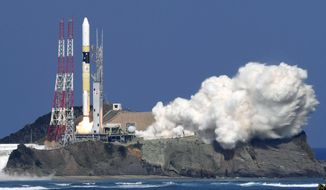 "Japan's rocket H-2A is launched, carrying aboard a green gas observing satellite ""Ibuki-2""  and KhalifaSat, a UAE satellite, Tanegashima, southern Japan, Monday, Oct. 29, 2018. The Japanese rocket carrying United Arab Emirates' first locally-made satellite has successfully lifted off from a space center in southern Japan. (Nozomi Endo/Kyodo News via AP)"