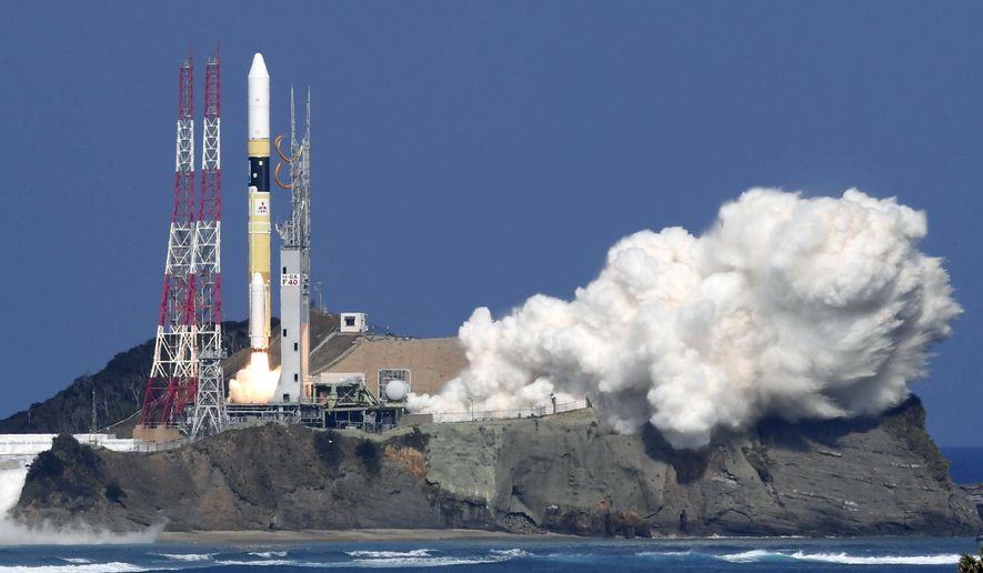 """Japan's rocket H-2A is launched, carrying aboard a green gas observing satellite """"Ibuki-2""""  and KhalifaSat, a UAE satellite, Tanegashima, southern Japan, Monday, Oct. 29, 2018. The Japanese rocket carrying United Arab Emirates' first locally-made satellite has successfully lifted off from a space center in southern Japan. (Nozomi Endo/Kyodo News via AP)"""