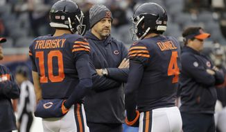 Chicago Bears head coach Matt Nagy talks to quarterbacks Mitchell Trubisky (10) and Chase Daniel (4) before an NFL football game against the New York Jets Sunday, Oct. 28, 2018, in Chicago. (AP Photo/Nam Y. Huh)