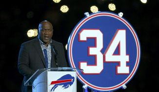 Former Buffalo Bills running back Thurman Thomas speaks during a halftime celebration retiring his number during an NFL football game between the Buffalo Bills and the New England Patriots, Monday, Oct. 29, 2018, in Orchard Park, N.Y. (AP Photo/Jeffrey T. Barnes)