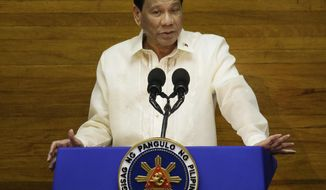 FILE - In this July 23, 2018, file photo, Philippine President Rodrigo Duterte gestures during his third State of the Nation Address at the House of Representatives in Quezon city, Philippines. Duterte put the corruption-plagued Bureau of Customs temporarily under military control amid a scandal after two huge shipments of illegal drugs reportedly slipped past through the port of Manila. (AP Photo/Aaron Favila, File)