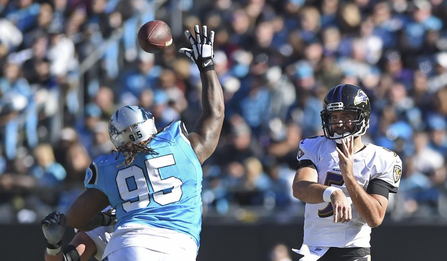 Baltimore Ravens' Joe Flacco (5) throws a pass over Carolina Panthers' Dontari Poe (95) in the second half of an NFL football game in Charlotte, N.C., Sunday, Oct. 28, 2018. (AP Photo/Mike McCarn) **FILE**