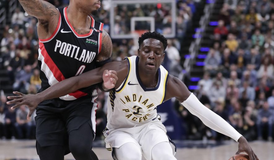 Indiana Pacers guard Darren Collison (2) drives on Portland Trail Blazers guard Damian Lillard (0) during the first half of an NBA basketball game in Indianapolis, Monday, Oct. 29, 2018. (AP Photo/Michael Conroy)