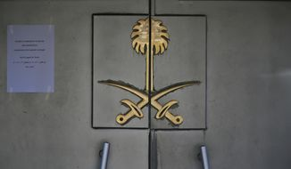 The entrance to Saudi Arabia's Consulate in Istanbul, Sunday, Oct. 28, 2018. The post to the left, notifies in Turkish and Arabic that the consulate will remain closed Oct. 29 because of national holiday in Turkey. (AP Photo/Lefteris Pitarakis)