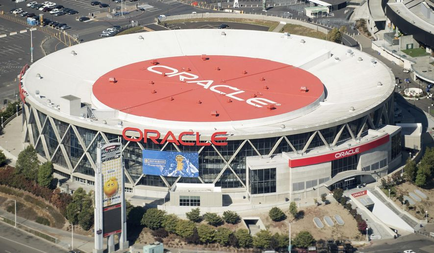 FILE - In this Oct. 5, 2017, file photo, the Oracle Arena, home of the Golden State Warriors, is pictured in Oakland, Calif. An arbitrator says the Golden State Warriors must pay roughly $40 million for renovations at the Oakland arena they are leaving. The government agency that manages the Oracle Arena announced the arbitrator's decision Monday, Oct. 29, 2018. (AP Photo/Noah Berger, File)