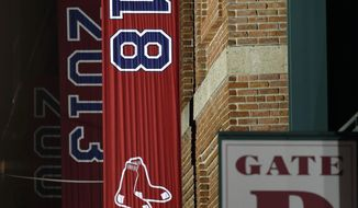 The 2018 World Series baseball championship banner hangs outside Fenway Park in Boston, Monday, Oct. 29, 2018. The Boston Red Sox won the series against the Los Angeles Dodgers on Sunday in Los Angeles. (AP Photo/Michael Dwyer)