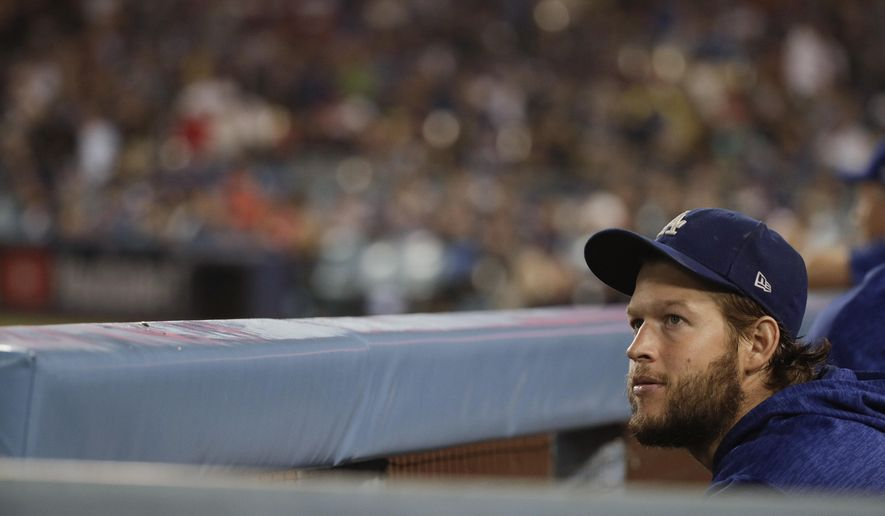 Los Angeles Dodgers starting pitcher Clayton Kershaw watches from the dugout during the ninth inning in Game 5 of the World Series baseball game against the Boston Red Sox on Sunday, Oct. 28, 2018, in Los Angeles. (AP Photo/Jae C. Hong)