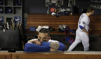 Los Angeles Dodgers' Manny Machado stands in the dugout after Game 5 of baseball's World Series against the Los Angeles Dodgers on Sunday, Oct. 28, 2018, in Los Angeles. The Red Sox won 5-1 to win the series 4 game to 1. (AP Photo/Jae C. Hong) **FILE**