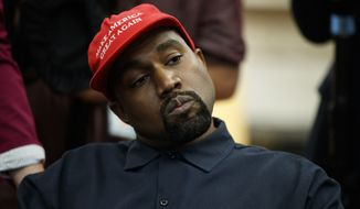 Rapper Kanye West listens to a question from a reporter during a meeting in the Oval Office of the White House with President Donald Trump, Thursday, Oct. 11, 2018, in Washington. (AP Photo/Evan Vucci)