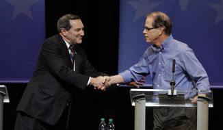 Democratic Sen. Joe Donnelly, left, shakes hands with Republican former state Rep. Mike Braun following a U.S. Senate Debate, Tuesday, Oct. 30, 2018, in Indianapolis. (AP Photo/Darron Cummings, Pool)