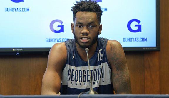 Georgetown University men's basketball player Jessie Govan (15) speaks during a news conference about the upcoming season at Georgetown University, Tuesday, Oct. 30, 2018, in Washington. (AP Photo/Pablo Martinez Monsivais) ** FILE **