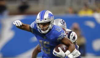 FILE-- In this Sept. 23, 2018 file photo, Detroit Lions wide receiver Golden Tate (15) runs the ball after a catch during an NFL football game against the New England Patriots in Detroit. The Philadelphia Eagles acquired Tate from the Detroit Lions in a trade, Tuesday, Oct. 30, 2018, for a third-round draft pick next year. (AP Photo/Paul Sancya) **FILE**