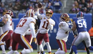 Washington Redskins quarterback Alex Smith (11) in action against the New York Giants during an NFL football game on Sunday, Oct. 28, 2018, in East Rutherford, N.J. (Brad Penner/AP Images for Panini) **FILE**