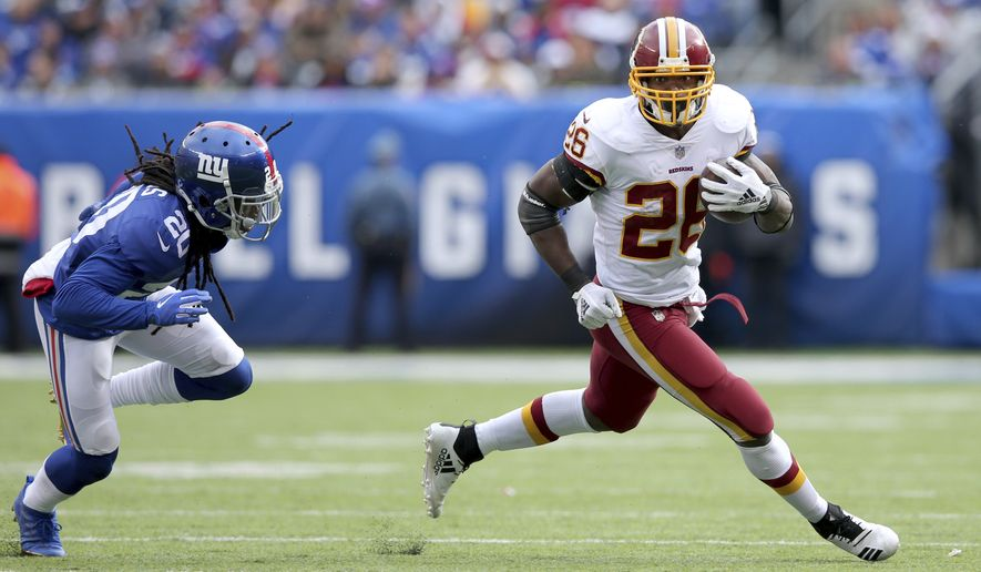 Washington Redskins running back Adrian Peterson (26) in action against New York Giants cornerback Janoris Jenkins (20) during an NFL football game on Sunday, Oct. 28, 2018, in East Rutherford, N.J. (Brad Penner/AP Images for Panini)