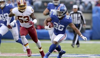 New York Giants running back Saquon Barkley (26) in action against the Washington Redskins linebacker Zach Brown (53) during an NFL football game on Sunday, Oct. 28, 2018, in East Rutherford, N.J. (Brad Penner/AP Images for Panini)