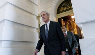 In this June 21, 2017 file photo, former FBI Director Robert Mueller, the special counsel probing Russian interference in the 2016 election, departs Capitol Hill following a closed door meeting in Washington. (AP Photo/Andrew Harnik)