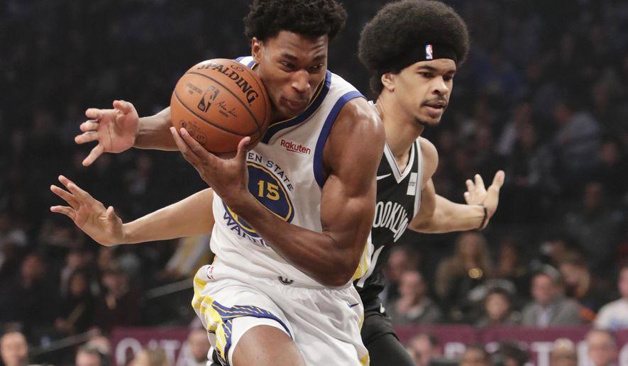 Golden State Warriors' Damian Jones (15) drives past Brooklyn Nets' Jarrett Allen, right, during the first half of an NBA basketball game Sunday, Oct. 28, 2018, in New York. (AP Photo/Frank Franklin II)