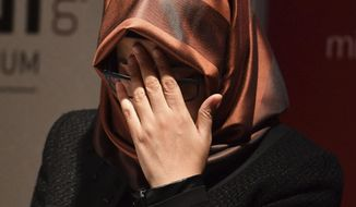 Hatice Cengiz, the fiancee of the killed Saudi journalist Jamal Khashoggi, reacts as she speaks during a memorial event for her fiancee at the Mechanical Engineers Institute in London, Monday Oct. 29, 2018.  The Al Sharq Forum think tank and Middle East Monitor have organised the event in honour of the murdered journalist Khashoggi who died in the Saudi consulate in Turkey. (John Stillwell/PA via AP)