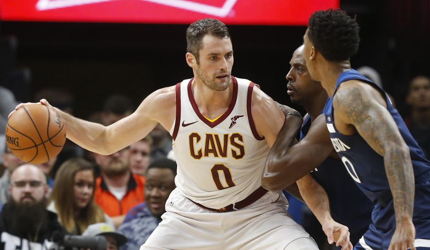 FILE - In this Oct. 19, 2018, file photo, Cleveland Cavaliers' Kevin Love, left, is double-teamed by Minnesota Timberwolves' Anthony Tolliver and Jeff Teague, right, in the first half of an NBA basketball game, in Minneapolis. Love could miss significant time with a foot injury that has bothered him since the preseason. Love will sit out his third straight game on Tuesday, Oct. 30, 2018, as the winless Cavs host Atlanta and look to end a six-game winless streak to start the season. (AP Photo/Jim Mone, File)
