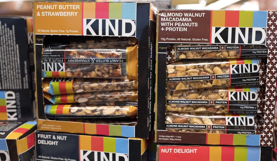 FILE - This Feb. 9, 2017, file photo shows Kind snack bars on display at a supermarket in New York. The government's definition of healthy came under scrutiny in late 2015, when the FDA warned Kind that its snack bars had too much fat to use the term. Kind pushed back, saying the fat came from nuts. (AP Photo/Mark Lennihan, File)