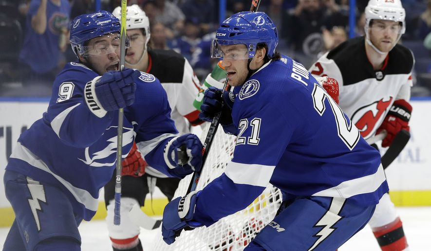 Tampa Bay Lightning center Brayden Point (21) celebrates with center Tyler Johnson (9) after Point scored against the New Jersey Devils during the second period of an NHL hockey game Tuesday, Oct. 30, 2018, in Tampa, Fla. (AP Photo/Chris O'Meara)