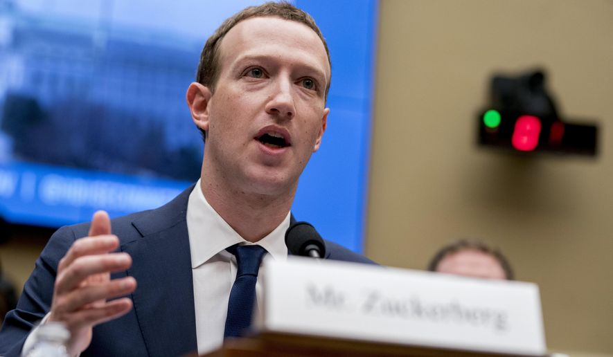 In this April 11, 2018, file photo, Facebook CEO Mark Zuckerberg testifies before a House Energy and Commerce hearing on Capitol Hill in Washington about the use of Facebook data to target American voters in the 2016 election and data privacy. (AP Photo/Andrew Harnik, File)