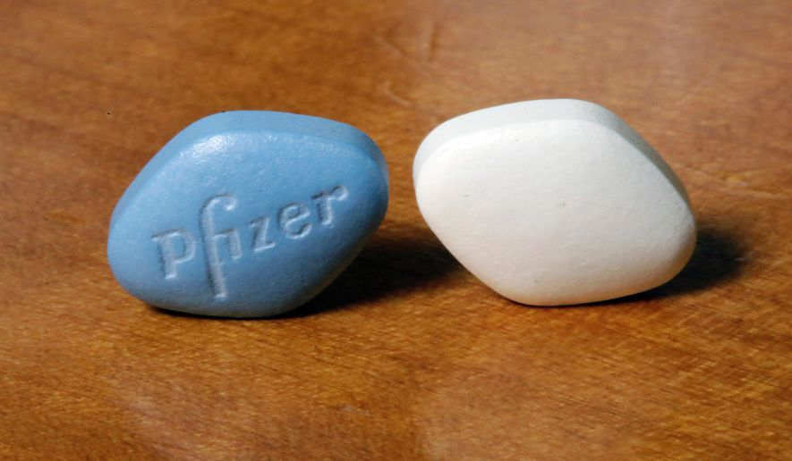 FILE- This Dec. 4, 2017, file photo shows a tablet of Pfizer's Viagra, left, and the company's generic version, sildenafil citrate, at Pfizer Inc., headquarters in New York. Pfizer Inc. reports earnings Tuesday, Oct. 30, 2018. (AP Photo/Richard Drew, File)