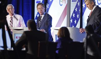 Democrat Ned Lamont, center, answers a question as he and the other two leading candidates for Connecticut Governor; petitioning candidate Oz Griebel, left, and Republican Bob Stefanowski face off in their final gubernatorial debate one week before the election Tuesday, Oct. 30, 2018 at at the Premier Ballroom at Foxwoods in Ledyard, Conn. (Sean D. Elliot/The Day via AP)