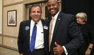Candidate Eddie Edwards, right, Republican nominee for New Hampshire's 1st Congressional District poses for a quick picture with former New Jersey Gov. Chris Christie at the NHGOP Rally For The Midterms event in Bedford, N.H., Tuesday, Oct. 30, 2018. (AP Photo/Cheryl Senter)