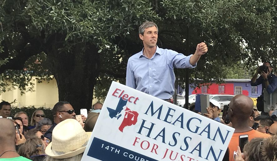Beto O'Rourke, the 2018 Democratic Candidate for U.S. Senate in Texas, speaks before a crowd of supporters at a get out the vote event on Tuesday, Oct. 30, 2018 in Houston. (AP Photo/John L. Mone)