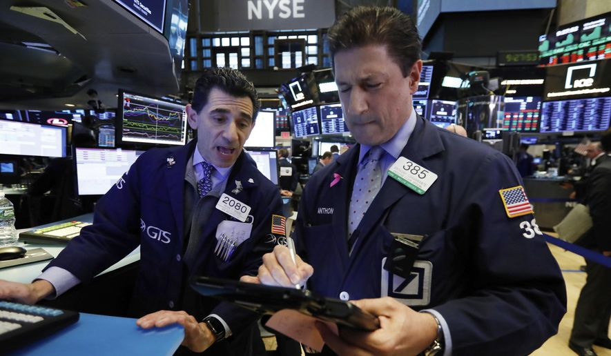 FILE- In this Oct. 24, 2018, file photo specialist Peter Mazza, left, and trader Anthony Carannante work on the floor of the New York Stock Exchange. The U.S. stock market opens at 9:30 a.m. EDT on Tuesday, Oct. 30. (AP Photo/Richard Drew, File)