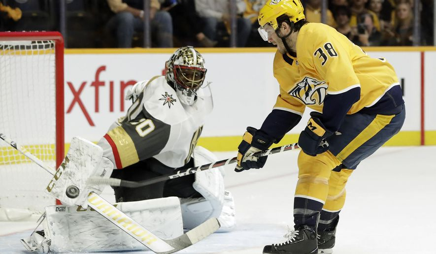 Nashville Predators right wing Ryan Hartman (38) scores his first goal of the game against Vegas Golden Knights goaltender Malcolm Subban (30) in the second period of an NHL hockey game Tuesday, Oct. 30, 2018, in Nashville, Tenn. (AP Photo/Mark Humphrey)