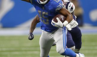 FILE-- In this Sept. 23, 2018 file photo, Detroit Lions wide receiver Golden Tate (15) runs the ball after a catch during an NFL football game against the New England Patriots in Detroit. The Philadelphia Eagles acquired Tate from the Detroit Lions in a trade, Tuesday, Oct. 30, 2018, for a third-round draft pick next year. (AP Photo/Paul Sancya)