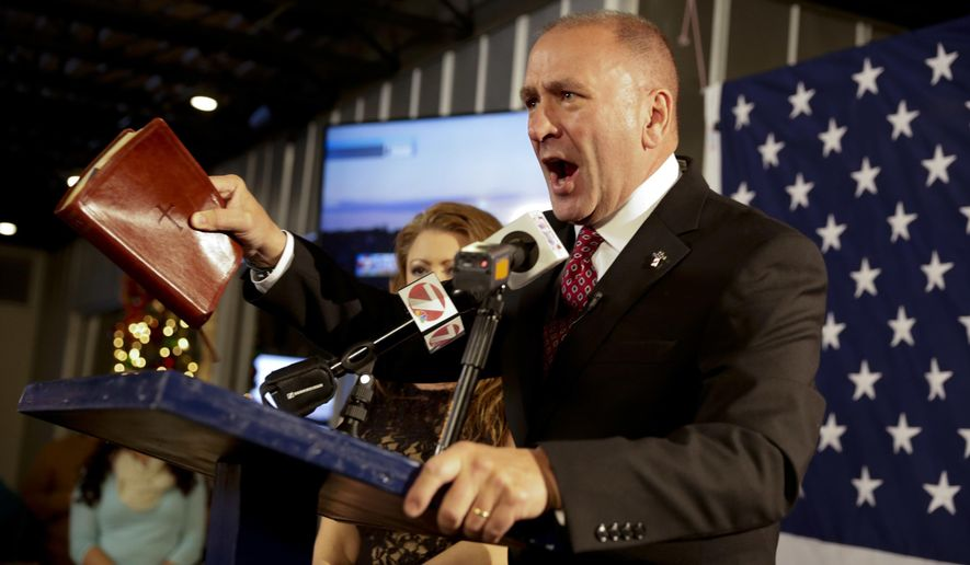 In this Dec. 10, 2016, file photo, Republican candidate Clay Higgins, with his wife, Becca, addresses supporters after his victory in Louisiana's 3rd Congressional District run-off election in Lake Charles, La. (Lee Celano/The Daily Advertiser via AP, File)