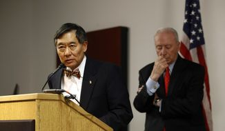 University of Maryland president Wallace Loh, left, speaks at a news conference in front of James Brady, chairman of the University System of Maryland Board of Regents, following the board's recommendation that football head coach DJ Durkin retain his job, Tuesday, Oct. 30, 2018, in Baltimore. Durkin has been on paid administrative leave since August, following the death of a player who collapsed during practice and an investigation of bullying by the Maryland coaching staff. (AP Photo/Patrick Semansky) **FILE**
