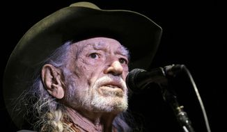 In this Jan. 7, 2017, file photo, Willie Nelson performs in Nashville, Tenn. The Recording Academy's Producers & Engineers Wing will honor Nelson days before the 2019 Grammy Awards. (AP Photo/Mark Humphrey, File)
