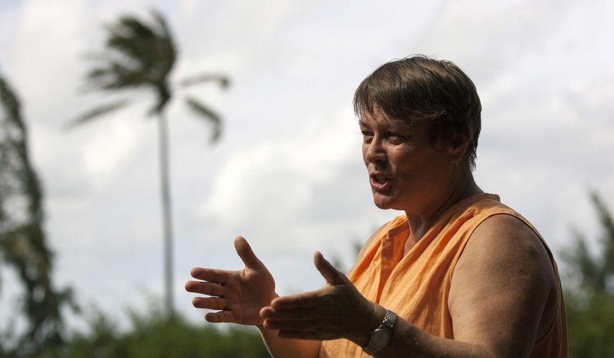 """In this Sept. 28, 2015 file photo, Hawaii Institute of Marine Biology director Ruth Gates talks about her project to create """"super coral"""" near her lab on Coconut Island in Kaneohe, Hawaii. Gates, who dedicated much of her career to saving the world's fragile and deteriorating coral reefs, has died at age 56. The University of Hawaii, where Gates was the director of the Hawaii Institute of Marine Biology, said Tuesday, Oct. 30, 2018, that the researcher died in Honolulu on Thursday, Oct. 25, 2018.  (AP Photo/Caleb Jones, File)"""