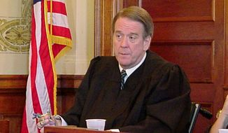 """FILE - In this Nov. 18, 2003, file photo, South Dakota State Supreme Court Justice Steven Zinter listens during a case in Pierre, S.D. Zinter, hailed as """"a towering figure in South Dakota law"""" who served on the state's highest court for 16 years, died Tuesday, Oct. 30, 2018, of complications from routine surgery, a court spokesman said. He was 68. (AP Photo/Joe Kafka, File)"""
