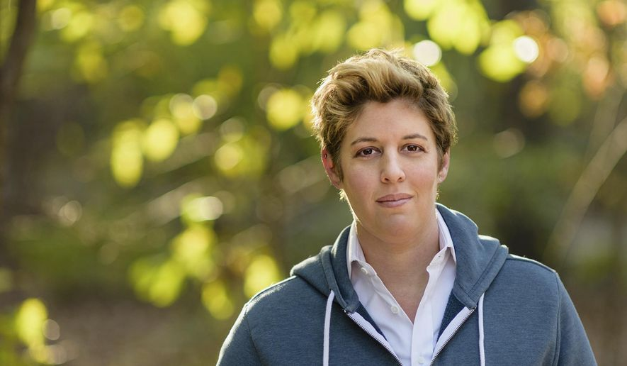 """In this 2017 photo made available by Sally Kohn, she poses for a portrait. For a book she published in 2018, """"The Opposite of Hate,"""" she reached out to several of her own Twitter trolls, conversing with them about the reasons for their vitriol and in some cases receiving apologies. (Paul Takeuchi/Sally Kohn via AP)"""