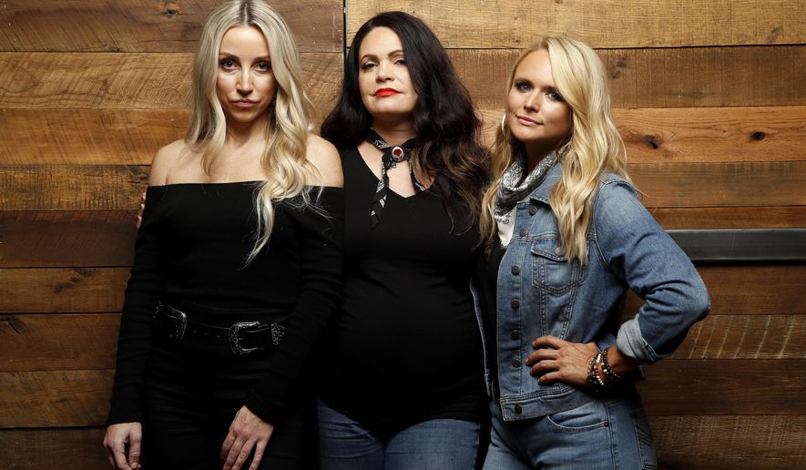 """In this Oct. 1, 2018 photo, Ashley Monroe, from left, Angaleena Presley and Miranda Lambert of the Pistol Annies pose for a photo at Sony Nashville in Nashville, Tenn., to promote their newest album, """"Interstate Gospel,"""" out on Friday. (Photos by Donn Jones/Invision/AP)"""