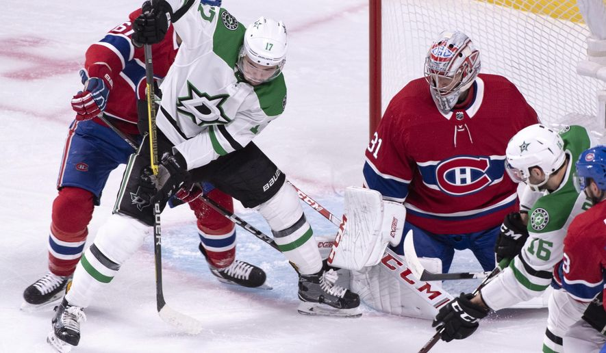 Dallas Stars' Devin Shore, second from left, tries to take control of the puck in front of Montreal Canadiens goaltender Carey Price during the first period of an NHL hockey game, Tuesday, Oct. 30, 2018, in Montreal. (Paul Chiasson/The Canadian Press via AP)