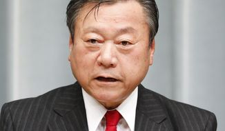 In this Oct. 2, 2018, photo, Japan's Olympic Minister Yoshitaka Sakurada speaks during a news conference in Tokyo. The minister in charge of the Tokyo Olympics says national government spending on the event is billions less than a recent national government audit showed. (Kyodo News via AP)