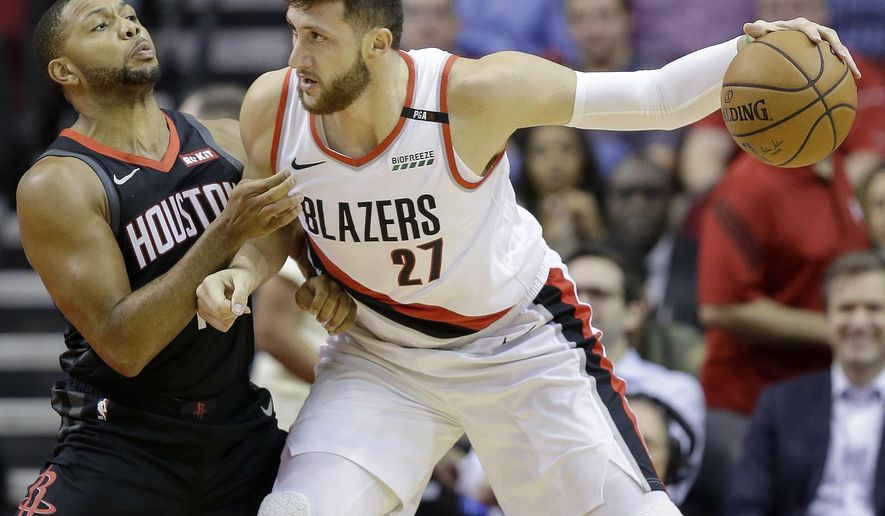 Portland Trail Blazers center Jusuf Nurkic (27) dribbles as Houston Rockets guard Eric Gordon defends during the first half of an NBA basketball game, Tuesday, Oct. 30, 2018, in Houston. (AP Photo/Eric Christian Smith)