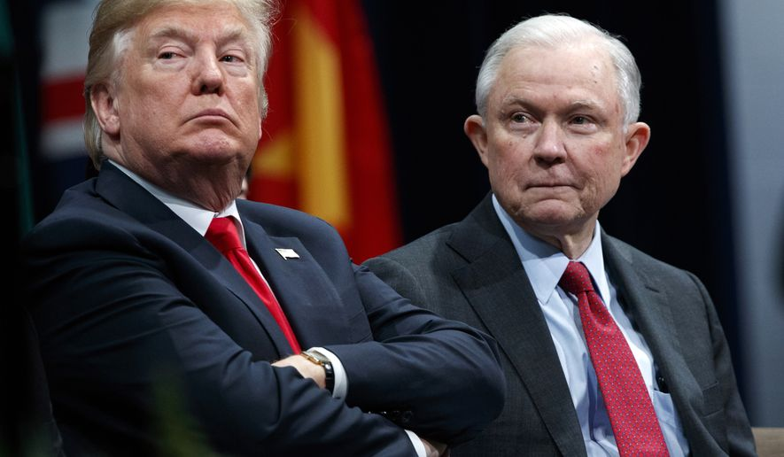 In this Dec. 15, 2017 file photo, President Donald Trump, left, appears with Attorney General Jeff Sessions during the FBI National Academy graduation ceremony in Quantico, Va. Trump, an ardent supporter of capital punishment, recently called for the death penalty for the man accused of killing 11 people in a Pittsburgh synagogue and Sessions has so far approved at least a dozen death penalty prosecutions over the past two years, according to court filings tracked by the Federal Death Penalty Resource Counsel, with cases ranging from the high profile to the relatively obscure. (AP Photo/Evan Vucci, File)