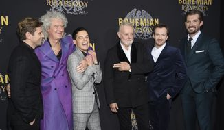 """Actor Allen Leech, left, musician Brian May, actor Rami Malek, musician Roger Taylor, actor Joe Mazzello and actor Gwilym Lee pose together at the premiere of """"Bohemian Rhapsody"""" at The Paris Theatre on Tuesday, Oct. 30, 2018, in New York. (Photo by Evan Agostini/Invision/AP)"""