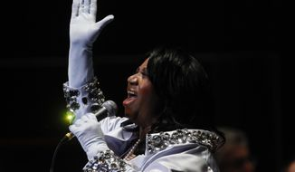 FILE- In this July 27, 2010 photo, Aretha Franklin performs at The Mann Center for the Performing Arts in Philadelphia. Franklin's 4,148-square-foot brick Colonial-style house in Bloomfield Township, Mich., is listed for $800,000. It offers five bedrooms, seven bathrooms and access to the gated community's pool and tennis courts. Franklin was 76 and living in downtown Detroit when she died in August from advanced pancreatic cancer. (AP Photo/Matt Rourke, File)