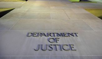 In this May 14, 2013, photo, the Department of Justice headquarters building in Washington is photographed early in the morning. (Associated Press) **FILE**
